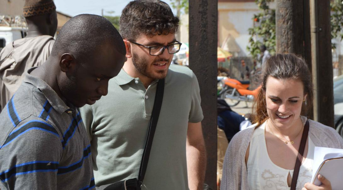 Projects Abroad French Language Project volunteers interacting with locals in the while on a trip around the city